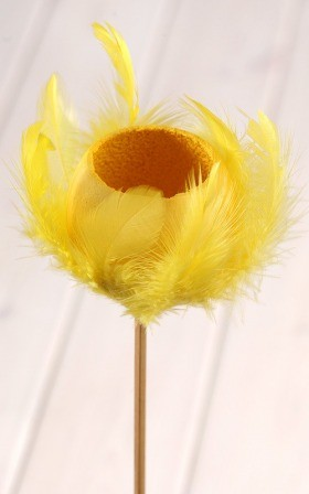 Bell cup on stick with feathers, yellow