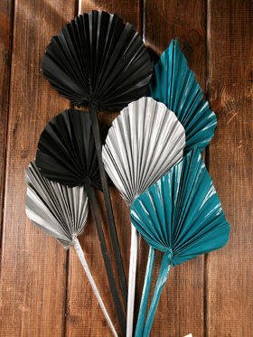 Bunch of dry palm leaves - black, silver, blue
