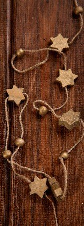 Garland of wooden gold stars on string 250cm