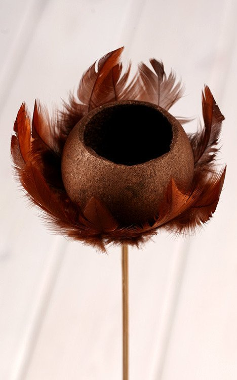 Bell cup on stick with feathers, brown