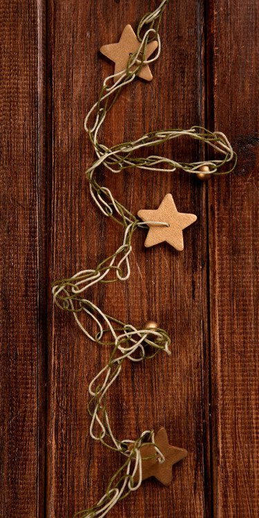 Garland of gold stars on olive green-cream string 350cm