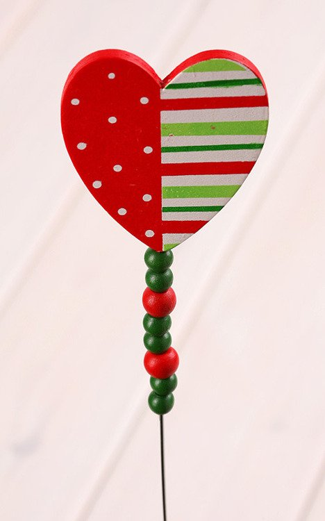 Wooden heart with beadings on stick