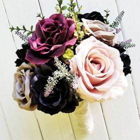 A bouquet of dried and artificial plants, artificial flowers, dried roses pastel colored