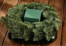 A wreath of spruce needles on a base of a sponge for live plants 30 cm