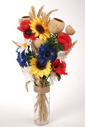 Bouquet of artificial poppy flowers, sunflowers, daisies and dried exotic flowers