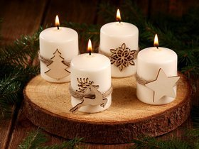 Christmas candle Candle with a Christmas tree on natural wood.