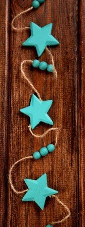Garland of turquoise stars on string 4.5cm lenght 150cm