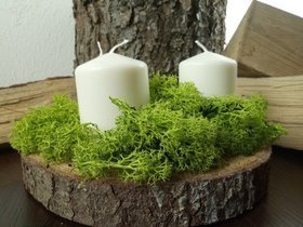 Natural composition of spring candles on a slice of wood with the addition of scratching.