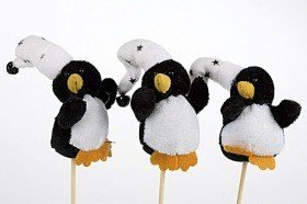 Penguins with a bell on stick.