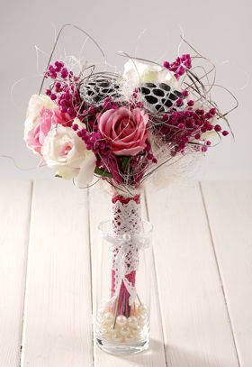 Pink-white bouquet in a glass dish with pearls about 40 cm