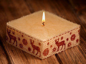 Rustic candle in jute- Brown Reindeer 10cm x 10cm