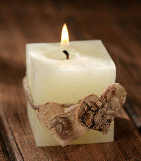 Rustic white candle with birch hearts
