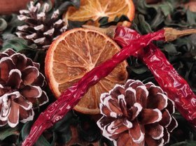 Winter potpourri - cinnamon, cones, peppers, oranges, dried green shavings