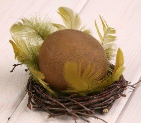 Wooden ball in nest, 10-12 cm, olive green