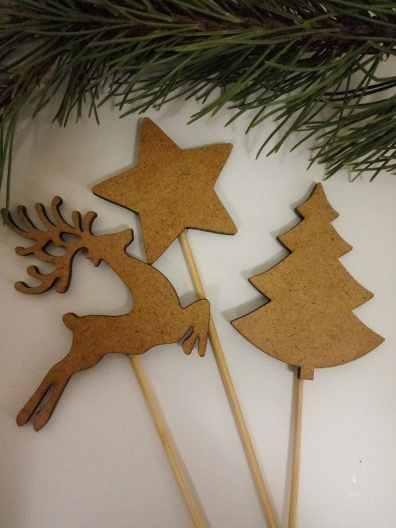 Christmas decorations. 6 cm wooden figurines on a 20 cm peak - 3 pcs / pack