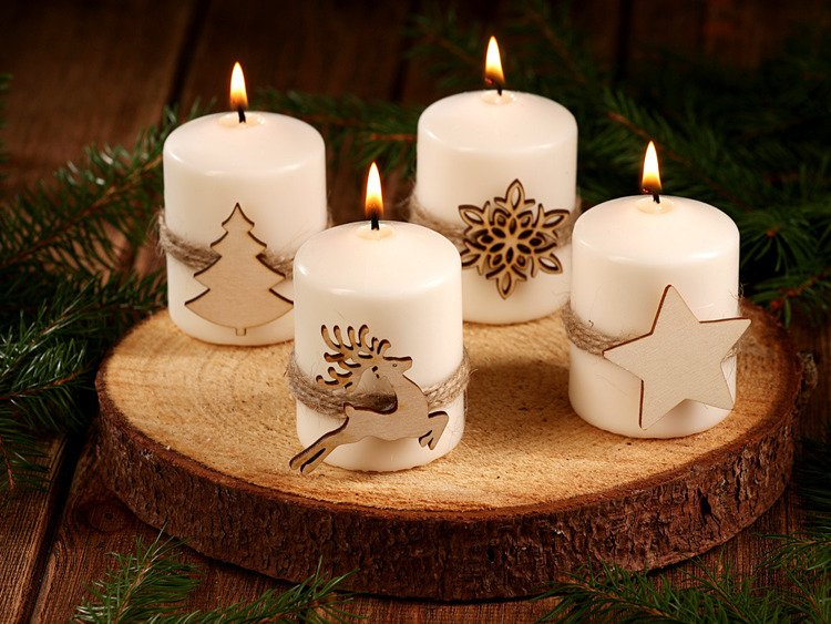Christmas candles on a slice of spruce wood.